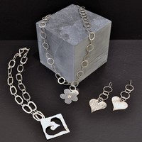 Handmade jewellery<br>Earings from £45 Bracelets and bangles from £85 Necklaces from£140 by Annie Wilson