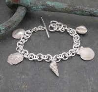 Five shell wrist chain<br>Wrist chains from £300 by Fay Page