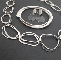 Necklace from  £215 Bangle from  £205 Earings from  £82 by Debra Heywood