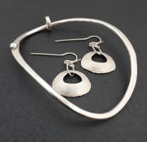 Silver bangle from  £160 and earings from  £82 by Debra Heywood