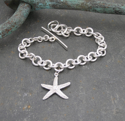Starfish wrist chain<br>Wrist chains from £210 by Fay Page